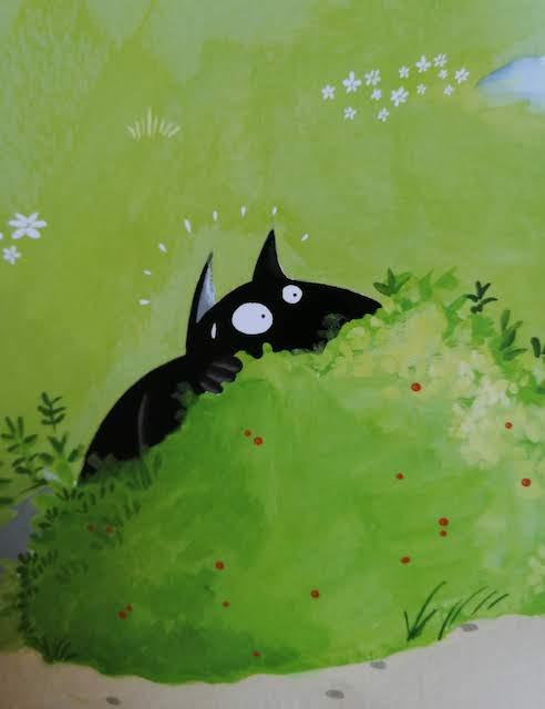 Vuk se skriva u grmlju
